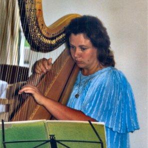 A Harpist plays at a Subud event at Anugraha